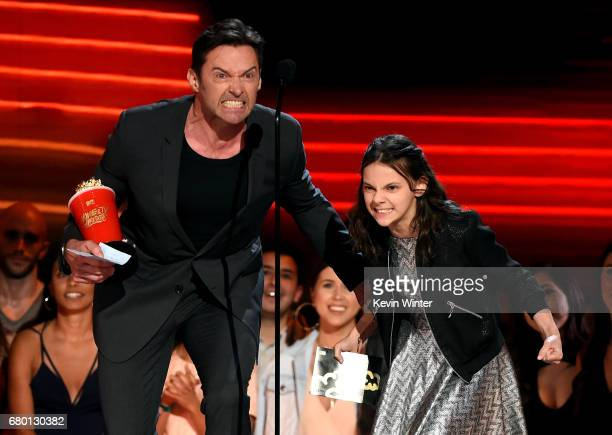 Actors Hugh Jackman and Dafne Keen accept Best Duo for 'Logan' onstage during the 2017 MTV Movie And TV Awards at The Shrine Auditorium on May 7 2017...