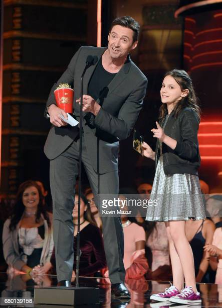 Actors Hugh Jackman and Dafne Keen accept the Best Duo award for 'Logan' onstage during the 2017 MTV Movie And TV Awards at The Shrine Auditorium on...