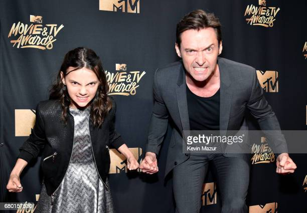 Actors Hugh Jackman and Dafne Keen attend the 2017 MTV Movie And TV Awards at The Shrine Auditorium on May 7 2017 in Los Angeles California