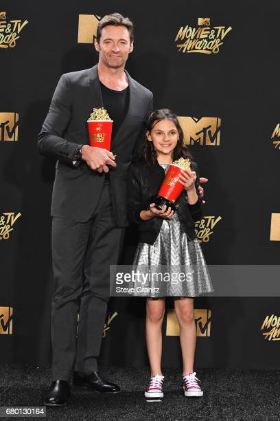 Actors Hugh Jackman and Dafne Keen pose in the press room at the 2017 MTV Movie and TV Awards at The Shrine Auditorium on May 7 2017 in Los Angeles...