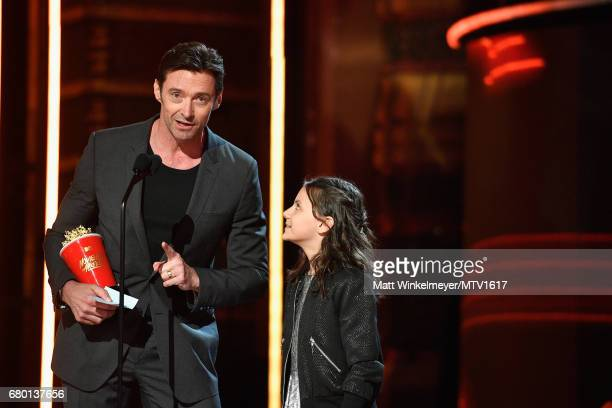 Actors Hugh Jackman and Dafne Keen speak onstage at the 2017 MTV Movie And TV Awards at The Shrine Auditorium on May 7 2017 in Los Angeles California