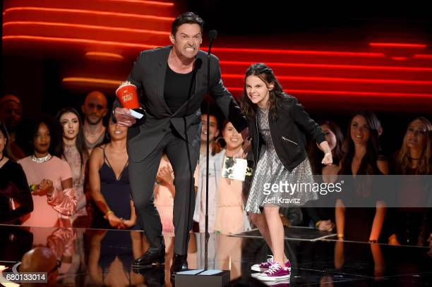 Actors Hugh Jackman and Dafne Keen speak onstage during the 2017 MTV Movie And TV Awards at The Shrine Auditorium on May 7 2017 in Los Angeles...