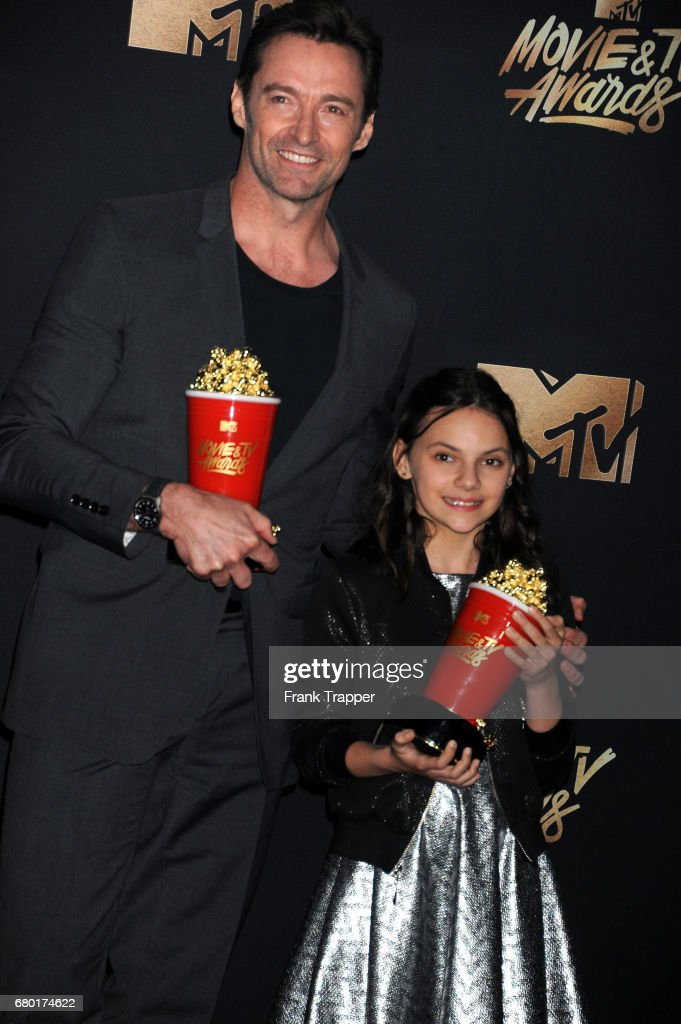 Actors Hugh Jackman and Dafne Keen, winners of Best Duo for 'Logan', poses in the press room during the 2017 MTV Movie And TV Awards at The Shrine Auditorium
