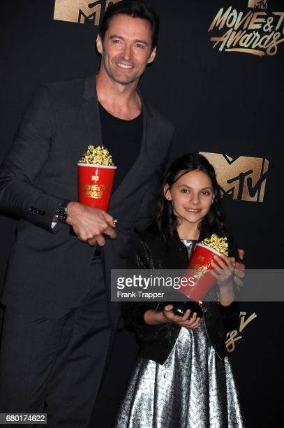 Actors Hugh Jackman and Dafne Keen winners of Best Duo for 'Logan' poses in the press room during the 2017 MTV Movie And TV Awards at The Shrine...
