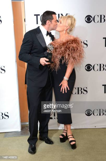 Actors Hugh Jackman and DeborraLee Furness pose in the 66th Annual Tony Awards press room at The Beacon Theatre on June 10 2012 in New York City