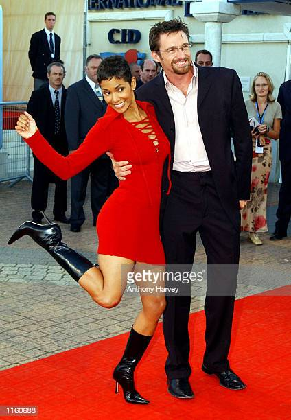 Actors Hugh Jackman and Halle Berry pose at the premiere of Swordfish September 1 2001 at the Deauville Festival of American Cinema in Deauville...
