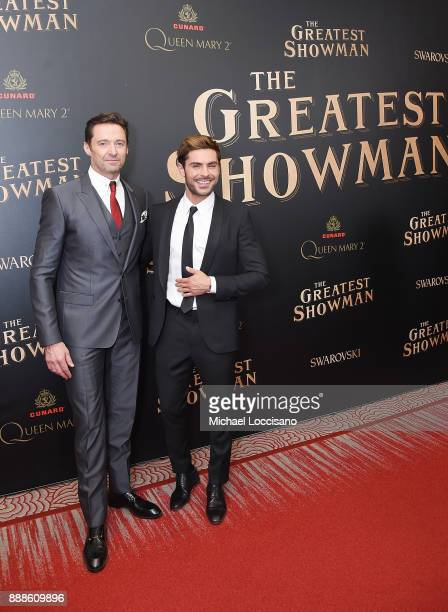 Actors Hugh Jackman and Zac Efron attend the The Greatest Showman World Premiere aboard the Queen Mary 2 at the Brooklyn Cruise Terminal on December...