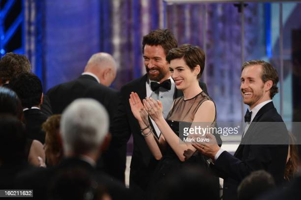 Actors Hugh Jackman Anne Hathaway and Adam Shulman attend the 19th Annual Screen Actors Guild Awards held at The Shrine Auditorium on January 27 2013...