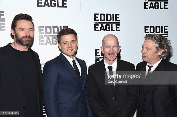 Actors Hugh Jackman Taron Egerton former skijumper Michael 'Eddie' Edwards and director Dexter Fletcher attend the 'Eddie The Eagle' New York...