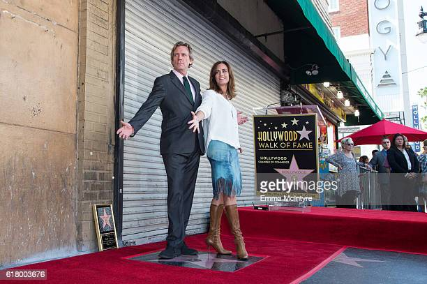 Actors Hugh Laurie and Diane Farr attend 'Hugh Laurie honored with star on the Hollywod Walk of Fame' on October 25 2016 in Hollywood California