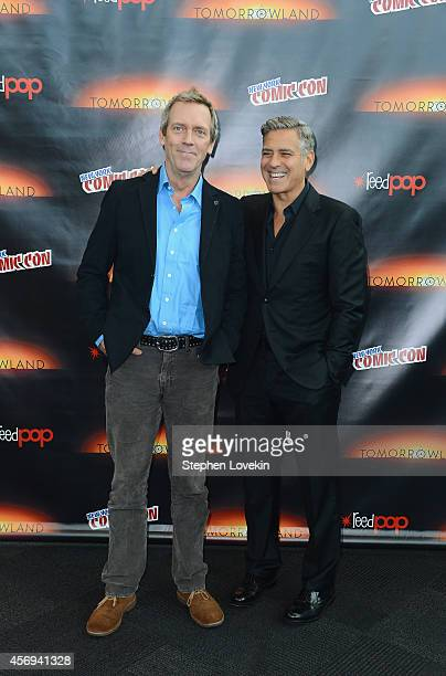 Actors Hugh Laurie and George Clooney attend Walt Disney Studios' 2014 New York Comic Con presentations of Big Hero 6 and Tomorrowland at the Javits...