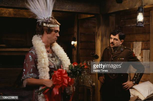 Actors Hugh Laurie and Rowan Atkinson in a scene from episode 'Major Star' of the BBC television sitcom 'Blackadder Goes Forth', September 1989.