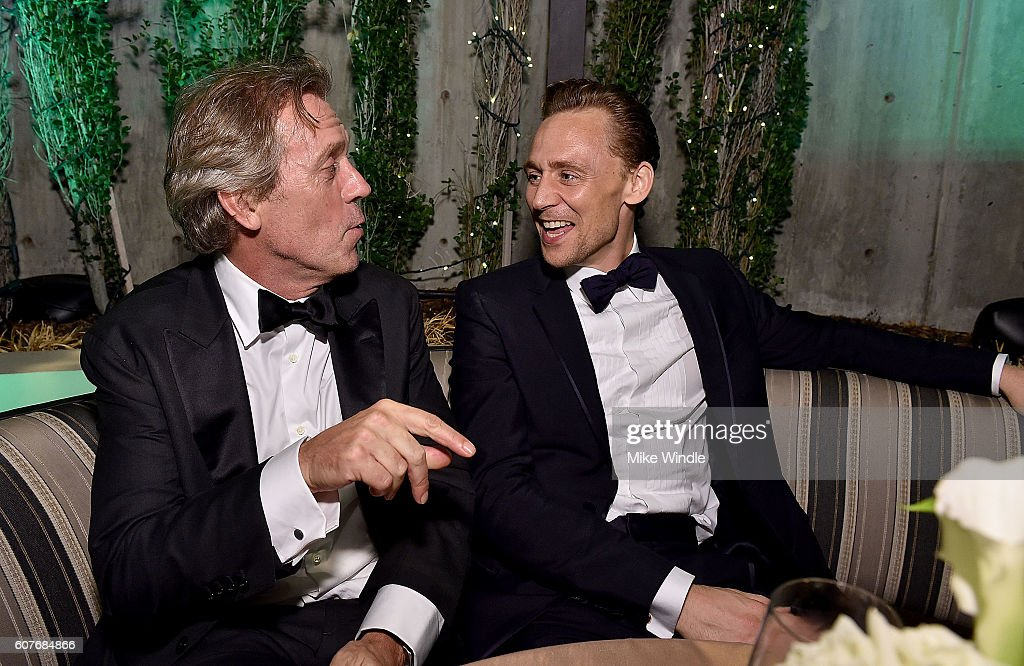 Actors Hugh Laurie (L) and Tom Hiddleston attend AMC Networks Emmy Party at BOA Steakhouse on September 18, 2016 in West Hollywood, California.