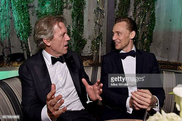 Actors Hugh Laurie and Tom Hiddleston attend AMC Networks Emmy Party at BOA Steakhouse on September 18, 2016 in West Hollywood, California.