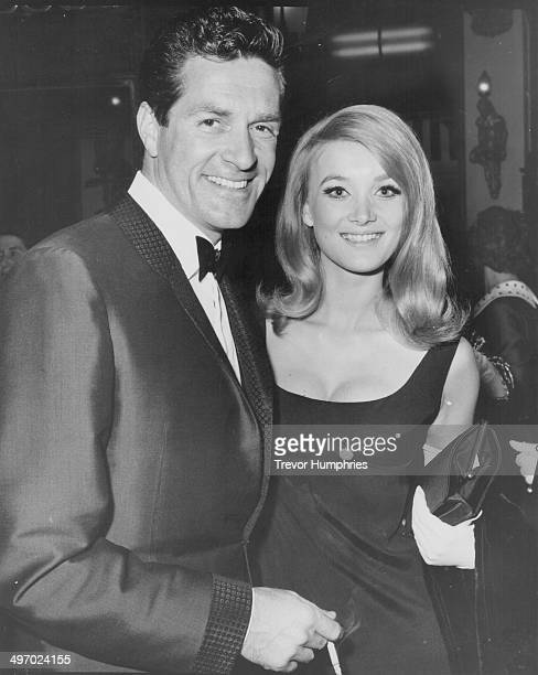 Actors Hugh O'Brian and Barbara Bouchet arriving at the premiere of the movie 'In Harm's Way' Plaza Cinema Leicester Square May 15th 1965