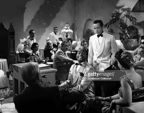 Actors Humphrey Bogart and Dooley Wilson pose for a publicity still for the Warner Bros film 'Casablanca' in 1942 in Los Angeles, California.