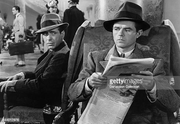 Actors Humphrey Bogart and Elisha Cook Jr pose for a publicity still for the Warner Bros film 'The Maltese Falcon' in 1941 in Los Angeles California