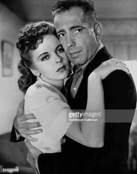 Actors Humphrey Bogart and Ida Lupino pose for a publicity still for the Warner Bros film 'High Sierra' in 1941 in Los Angeles California