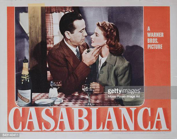 Actors Humphrey Bogart and Ingrid Bergman fall in love on a poster for the Warner Bros film 'Casablanca' 1942