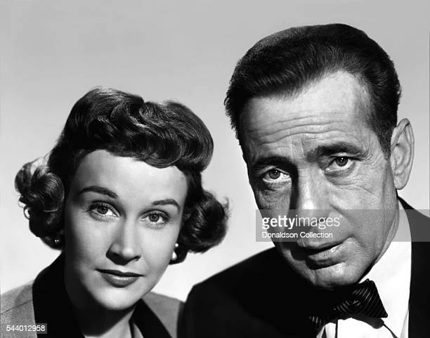 Actors Humphrey Bogart and Kim Hunter pose for a publicity still for the 20th CenturyFox film 'Deadline USA' in 1952 in Los Angeles California