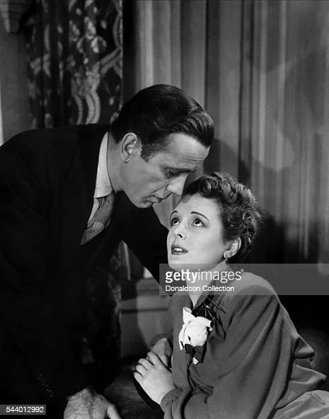 Actors Humphrey Bogart and Mary Astor pose for a publicity still for the Warner Bros film 'The Maltese Falcon' in 1941 in Los Angeles California