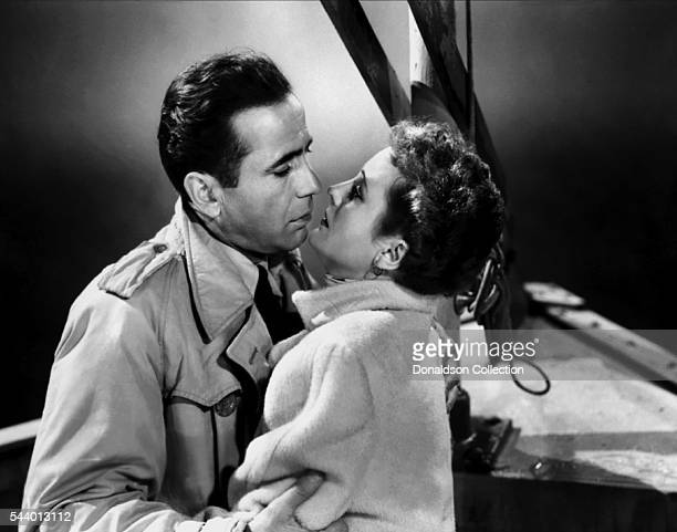 Actors Humphrey Bogart and Mary Astor pose for a publicity still for the Warner Bros film 'Across the Pacific' in 1942 in Los Angeles California