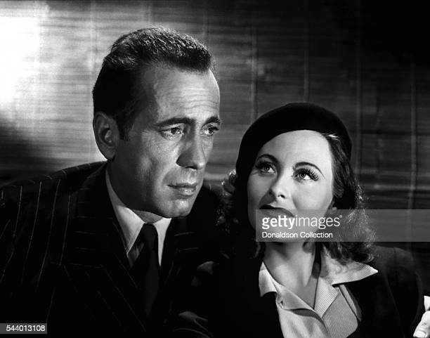 Actors Humphrey Bogart and Michele Morgan pose for a publicity still for the Warner Bros film 'Passage to Marseille' in 1944 in Los Angeles California