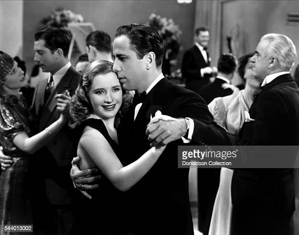 Actors Humphrey Bogart and Priscilla Lane pose for a publicity still for the Warner Bros film 'Men Are Such Fools' in 1938 in Los Angeles California