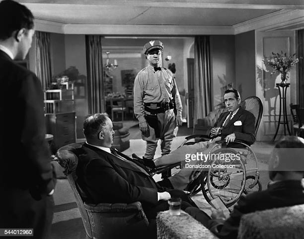 Actors Humphrey Bogart and Sydney Greenstreet pose for a publicity still for the Warner Bros film 'Conflict' in 1945 in Los Angeles California