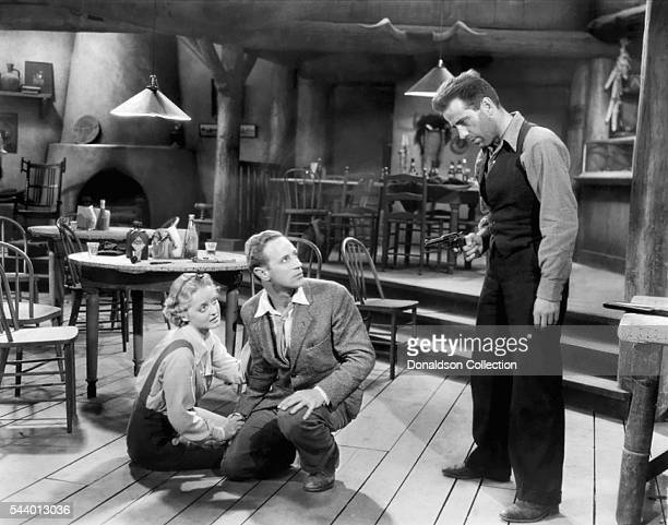 Actors Humphrey Bogart Bette Davis and Leslie Howard pose for a publicity still for the Warner Bros film 'The Petrified Forest' in 1936 in Los...