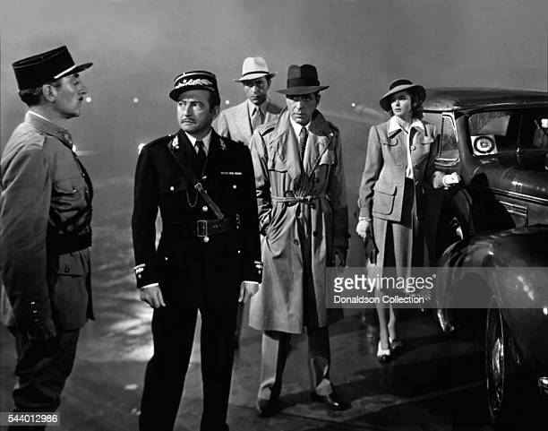Actors Humphrey Bogart Paul Henreid Claude Rains and Ingrid Bergman pose for a publicity still for the Warner Bros film 'Casablanca' in 1942 in Los...