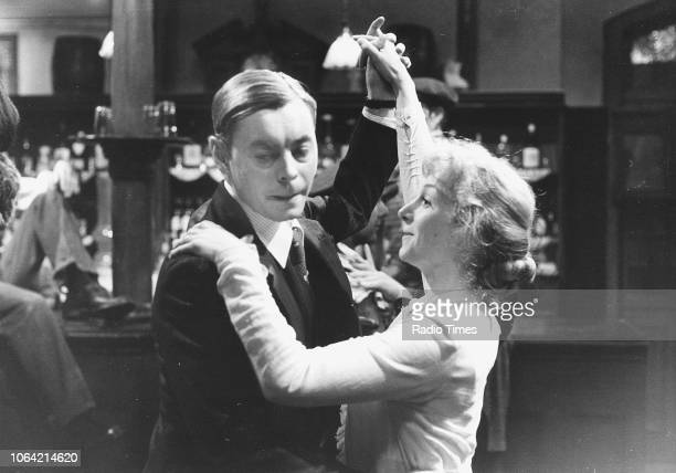 Actors Hywel Bennett and Cheryl Campbell dancing together in a scene from the television series 'Pennies from Heaven', January 23rd 1978.