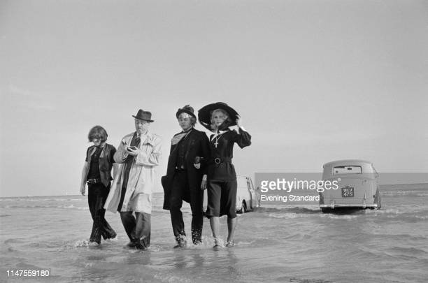 Actors Hywel Bennett , Richard Attenborough , Roy Holder, and Lee Remick filming a scene of British comedy film 'Loot', UK, 23rd September 1969.