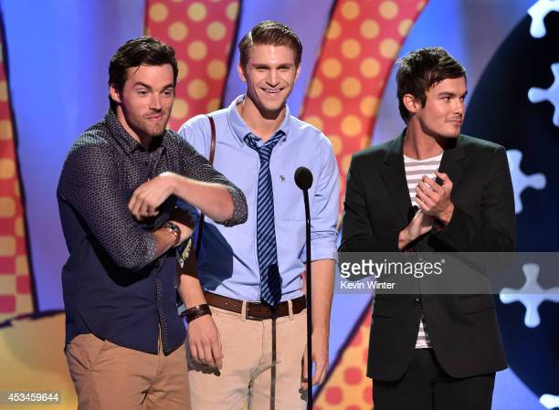 Actors Ian Harding Keegan Allen and Tyler Blackburn onstage during FOX's 2014 Teen Choice Awards at The Shrine Auditorium on August 10 2014 in Los...
