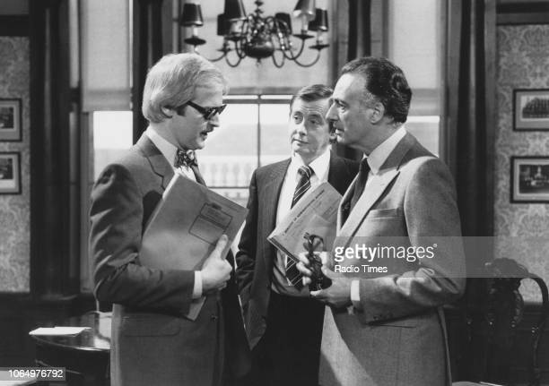 Actors Ian Lavender Derek Fowlds and Paul Eddington in a scene from episode 'The Challenge' of the television sitcom 'Yes Minister' November 14th 1982