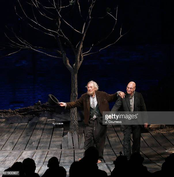 Actors Ian McKellen and Patrick Stewart perform a dance during curtain call at the opening night of Waiting For Godot at the Cort Theatre on November...