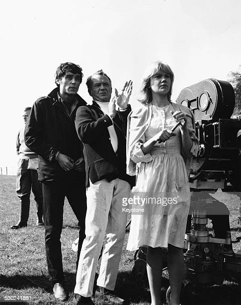 Actors Ian McShane and Hayley Mills with director John Mills discussing a scene on the set of the film 'Sky West and Crooked' Gloucestershire England...