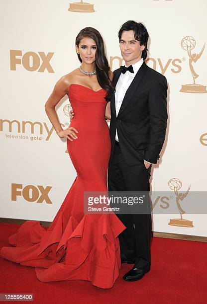 Actors Ian Somerhalder and Nina Dobrev arrive to the 63rd Primetime Emmy Awards at the Nokia Theatre L.A. Live on September 18, 2011 in Los Angeles,...