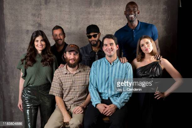 Actors Idina Menzel Adam Sandler directors Benjamin Safdie Lakeith Stanfield Joshua Safdie Kevin Garnett and Julia Fox from 'Uncut Gems' are...