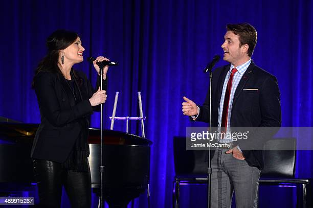 Actors Idina Menzel and James Snyder perform onstage at the Family Equality Council's 2014 Night at the Pier at Pier 60 on May 12 2014 in New York...