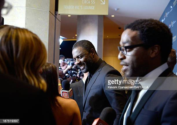 Actors Idris Elba and Chiwetel Ejiofor attend the 2013 BAFTA LA Jaguar Britannia Awards presented by BBC America at The Beverly Hilton Hotel on...
