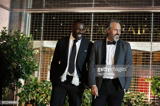 Actors Idris Elba and Mark Frost on the set of 100 Streets at the Hilton Hotel on August 29 2014 in London England