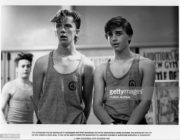 Actors Ilan MitchellSmith and Anthony Michael Hall talk in a scene of the Universal Studio movie Weird Science