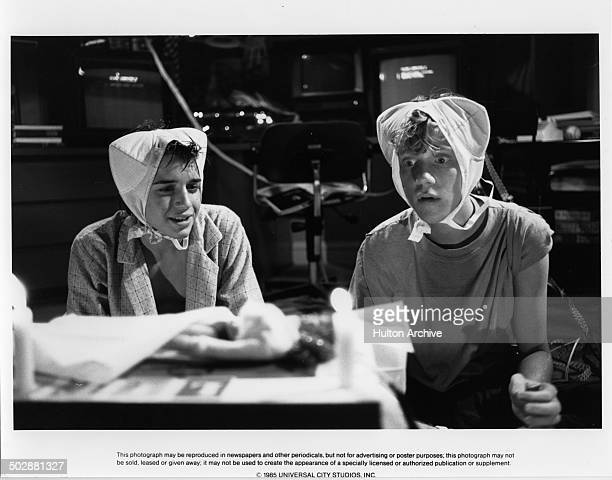 Actors Ilan MitchellSmith and Anthony Michael Hall wear bras on their heads in a scene of the Universal Studio movie 'Weird Science'