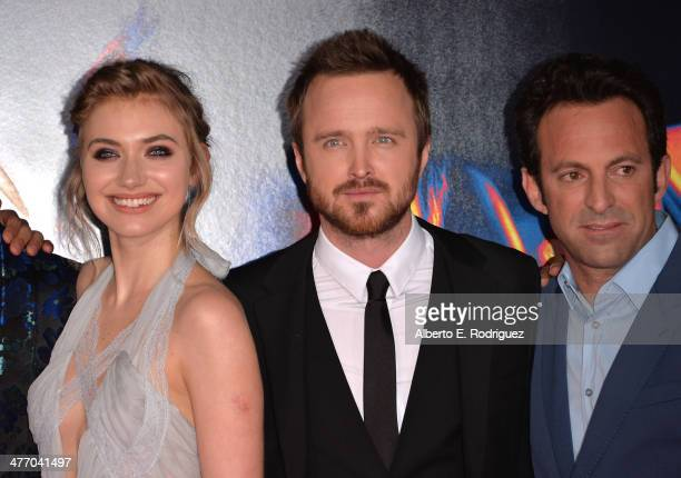 """Actors Imogen Pootsand Aaron Paul and Director Scott Waugh arrive for the premiere of DreamWorks Pictures' """"Need For Speed"""" at TCL Chinese Theatre on..."""