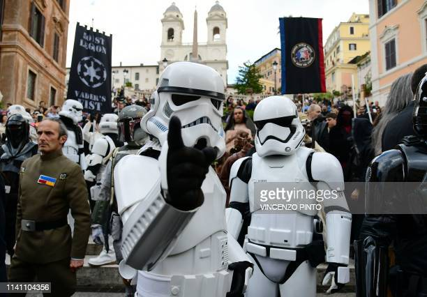 Actors impersonating Star Wars movie's characters pose on the Rome's Spanish Steps during an event to mark the Star Wars Day in Rome on May 4 2019