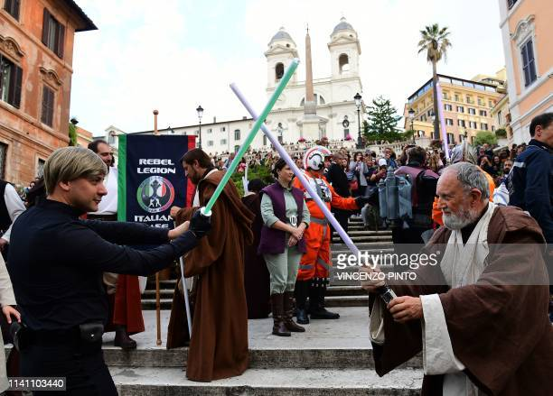 Actors impersonating Star Wars' ObiWan Kenobi and Luke Skywalker perform on the Rome's Spanish Steps during an event to mark the Star Wars Day in...