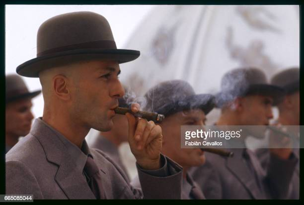 Actors in grey suits smoke cigars during the shooting of the movie Momo based on German writer Michael Ende's 1975 book