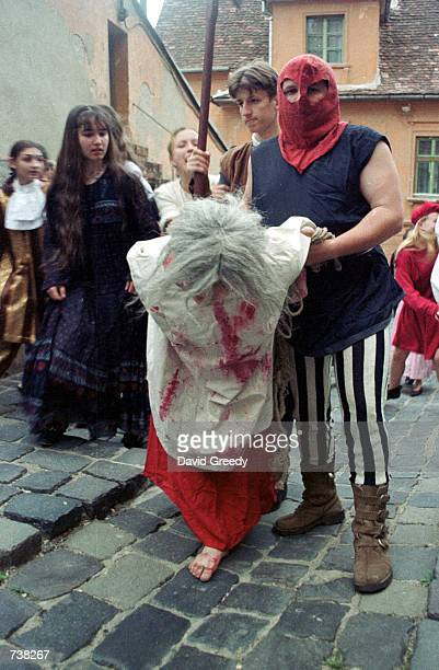 Actors in period costume stage a mock medieval witch trial May 9 2001 inside the walled city of Sighisoara Romania The mock trial helped kick off a...