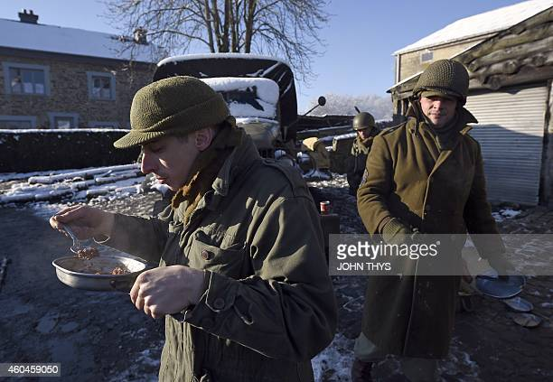 Actors in period US uniforms take part in the reanactment of the 70th anniversary of the Battle of the Ardennes also known as the Ardennes...